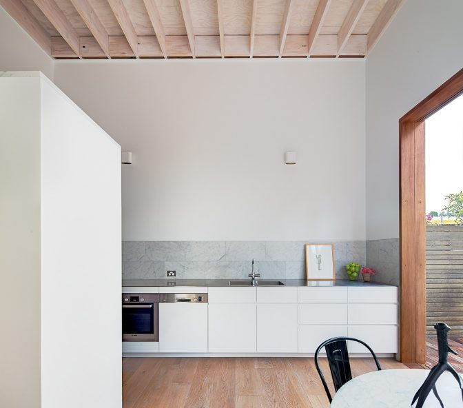 contemporary kitchen interior with marble splashback and exposed plywood joinery by australian architecture practice alexander &co