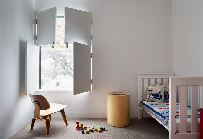children's bedroom with view to gum tree in bondi junction, sydney by alexander & co architecture and interior design studio