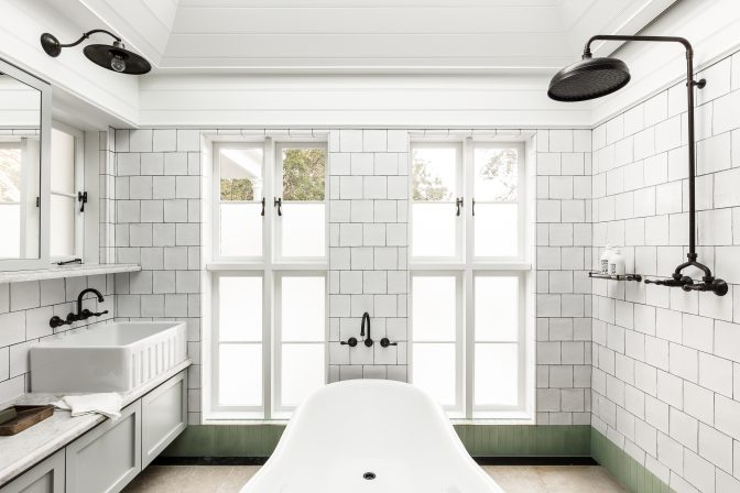 This second floor bathroom takes inspiration from a traditional wintergarden. It features timber ceiling panelling, a skylight and sage-green detailing.